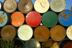 Barrels on end. A stack of grungy old oil drums at a music festival, ready to be set out as rubbish bins Stock Image