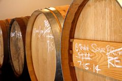 Barrels Filled with Aging Beer. A row of barrels filled with beer for aging royalty free stock image