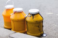 Barrels with foul wasted melting ice cream Stock Images
