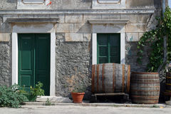 Barrels in front of house Royalty Free Stock Photography