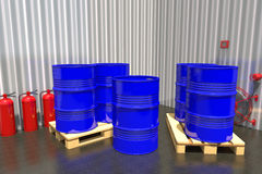 Barrels of fuel on a pallet are in the industrial warehouse. Royalty Free Stock Image