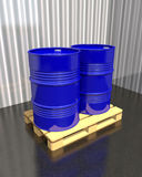 Barrels of fuel on a pallet in the industrial warehouse. Royalty Free Stock Photos