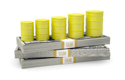 Barrels gas stand on pack of dollars Stock Photography