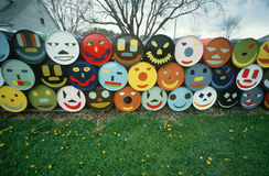 Barrels with happy faces painted on Stock Images