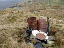 Barrels high up in the hills. There was probably a good reason for bringing these up here Stock Photo