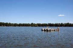 Barrels on the lake. Cruise on the lake, floating island Royalty Free Stock Image