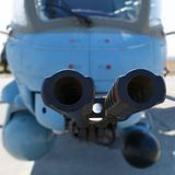 Barrels of modern helicopter cannon close-up Stock Image