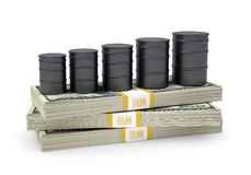 Barrels oil stand on pack of dollars Royalty Free Stock Image