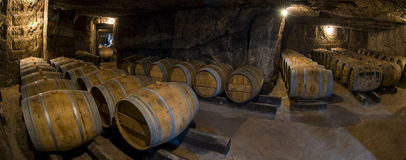 Barrels in old cellar, Bordeaux winery Stock Photography