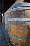 Barrels by old saloon in San Diego Stock Photo