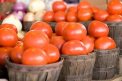 Barrels of onions and tomatoes Stock Photography