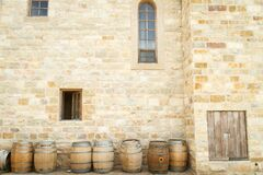 Barrels outside castle to store maturing wine Stock Photography