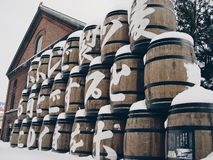 Wooden beer barrels covered in snow stock photography