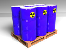 Barrels with a radioactive symbol on the pallet Royalty Free Stock Photos