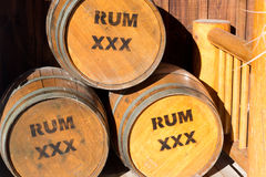 Barrels of Rum. Three wooden barrels of rum in afternoon sunlight Stock Photo