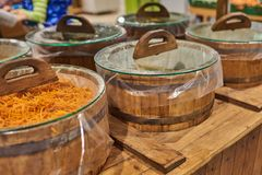 Barrels of sauerkraut and carrots at the store royalty free stock image