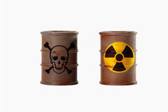 Barrels with signs of skull and crossbones and radioactivity on Stock Photo