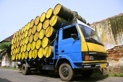 Barrels stacked atop truck Stock Image