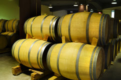 Barrels stacked in a Bulgarian winery. Selective focus Royalty Free Stock Photography