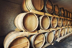 Barrels stacked in a wine cellar Stock Photos