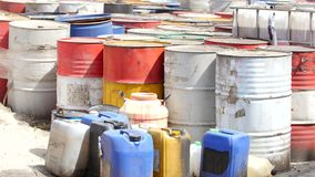 Barrels stand with spent oil products stock video footage