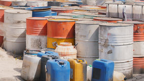 Barrels stand with spent oil products Stock Photos