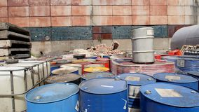 Barrels stand with waste oil and oil products stock footage