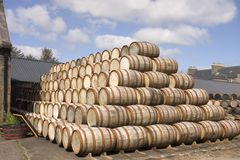 Barrels stcked in the distillery. Bourbon Barrels stacked up in the yard of a Scottish distillery ready for use royalty free stock photos