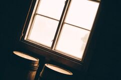 Barrels by sunny window Stock Photography