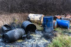 Barrels of toxic waste in nature. Pollution of the environment royalty free stock images