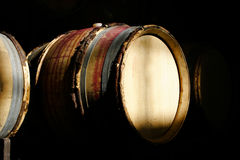 Barrels for wine aging. Wine barrels used to age wine is wrapped with bent willow tree branches Stock Photography