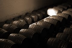 Barrels in the wine cellar. French Oak barrels with wine being stored in Pleisir de Merle wine cellar in Franschhoek, Western Cape, South Africa stock photos