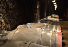 Barrels of wine in a cellar Stock Photos
