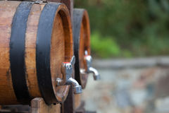 The barrels with wine standing on  street Stock Photo