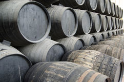Barrels of wine. Whiskey or wine barrels stacked in winery stock photo