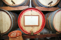 Barrels of wine in the wine cellar Stock Photo