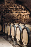 Barrels of wine in a wine cellar Royalty Free Stock Images