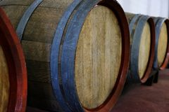 Barrels of wine at the winery farm. Closeup photo Royalty Free Stock Images