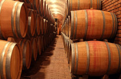 Barrels in the winery. An image from a winery cellar Royalty Free Stock Photography