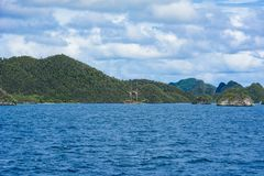 Barren chalk hills, sailer, Indonesia Royalty Free Stock Photo