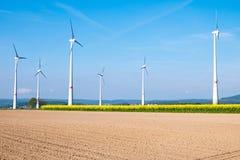 Barren field and windwheels Stock Photos