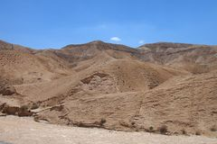 Barren Judaean Desert, Israel, Holy Lands. Barren and desolate Judaean Desert or Judean Desert, Israel and the West Bank, descends to the Dead Sea. Holy Lands royalty free stock photo