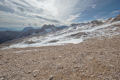 Barren landscape of gravel and snow Royalty Free Stock Photos
