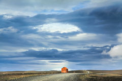 Barren landscape with old snowstorm shelter in Iceland. Panoramic view of barren landscape with old red snowstorm shelter at Kjolur highland road, Iceland Stock Photography