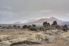 Barren landscape of Timanfaya Royalty Free Stock Photography