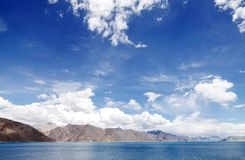 Barren mountains and blue pangong lake Royalty Free Stock Images