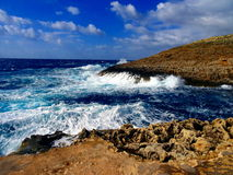 Barren shoreline. And sea in Malta with waves crashing Stock Photo