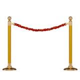 Barrera de oro con la cuerda roja Imagen de archivo