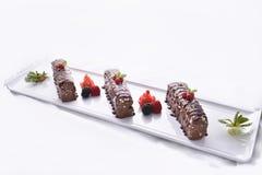 Barres de chocolat servies sur le plateau Images libres de droits