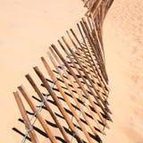 Barrière dans le sable Photo stock